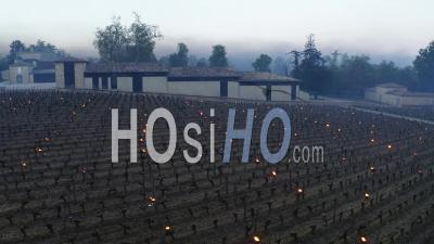 Aerial View Burning Candles At Chateau Figeac In The Bordeaux Vineyard During A Period Of Freezing - Video Drone Footage