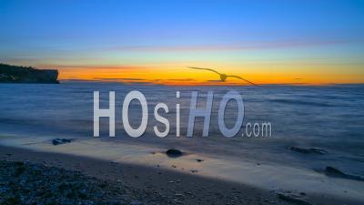 Sundown Over Calm Ocean In Time Lapse