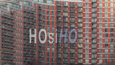 Day To Night Time-Lapse Of The Exterior Of A Modern Apartment Block At Night
