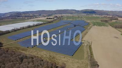 Solar Panels In A Solar Farm In Scotland, Uk - Video Drone Footage