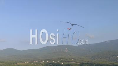 Ultralight Aircraft Flying Above French Riviera Landscape, Among Clouds, Flime From Airplane