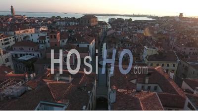 Flyover A Narrow Canal In Venice - Video Drone Footage