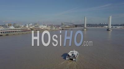 Aerial View Of Bordeaux Public Transport Boat On The Garonne, Chaban Delmas Bridge, France - Video Drone Footage